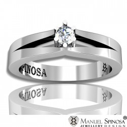 modern style solitaire white gold diamond ring.