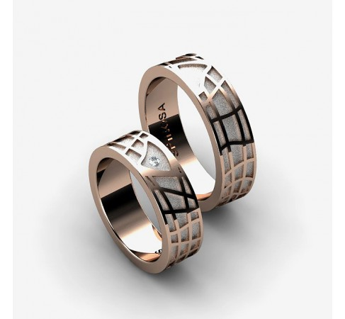 gold wedding ring with a geometric pattern design