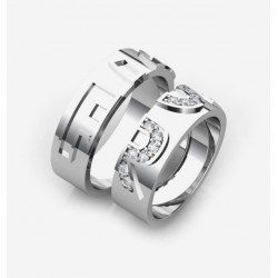 creative wedding ring with initials in brilliants on the bride's ring