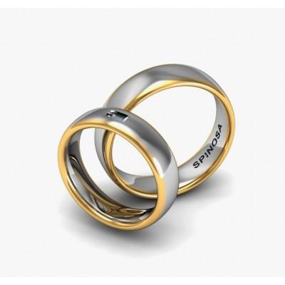 alianzas con forma media caña y un diamante en talla baguete