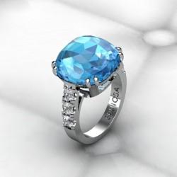 anillo con topacio azul en talla cojin y brillantes